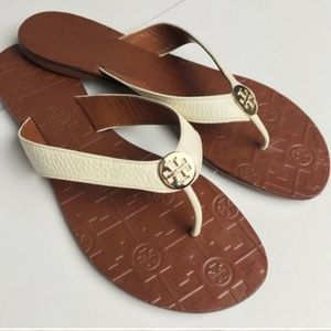 Tory Burch cream and gold flip flops size 7